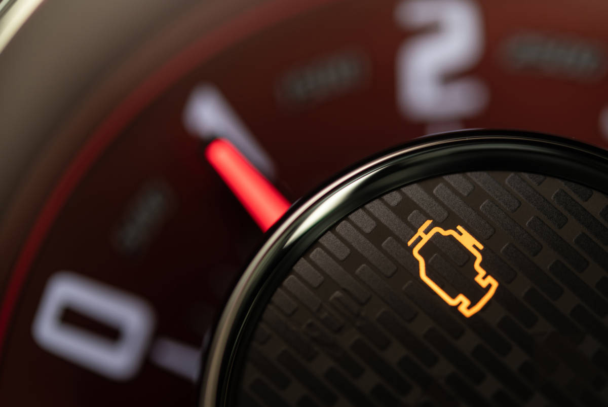 Check Engine Control Light on a Vehicle Dashboard
